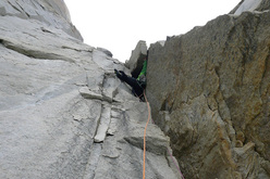 Much Mayr climbing the fist hard off-width of Waiting for Godot (750m, 7b) Torres del Paine, Patagonia.