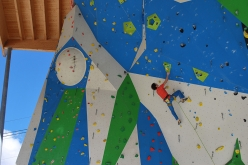 Adam Ondra climbing at the ADEL climbing wall at Campitello di Fassa, Italy