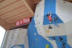 Adam Ondra attempting an 8c at the ADEL climbing wall at Campitello di Fassa, Italy