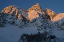 Perfect winter climbing conditions in Slovenian Alps. Pictured here the peak Štajerska Rinka.
