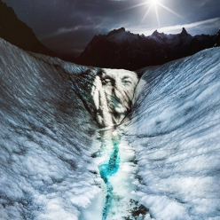 The face of Jeff Mercier in 'Ice Scream' projected by French artist Philippe Echaroux onto the Mer de Glace, Mont Blanc