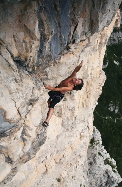 Manrico Dell'Agnola climbing the overhanging 8th pitch of the Cassin-Ratti route on Torre Trieste, Civetta, Dolomites