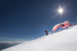 Hansjörg Auer taking off from the Marmolada Punta Rocca Summit. He landed on the ski slope above Canazei