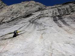 Manuele Panzeri climbing the slabs on pitch 1 of Via Napoleone in Val Torrone (Val Masino)
