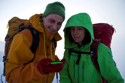 Ian Parnell and Ines Papert using a compass to navigate off the mountain.