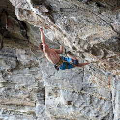 Adam Ondra working the crux section of what has become 'Silence', the hardest sport climb in the world and the world's first 9c