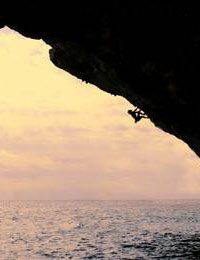 Chris Sharma high above the waves, Mallorca, Spain
