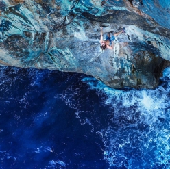 America's Chris Sharma making the first ascent of his Deep Water Solo testpiece 'Big Fish' 8c+/9a at Soller, Mallorca