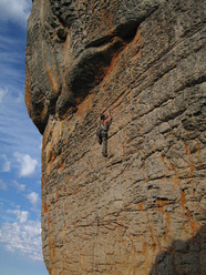 Climbing a 6b+ on Bastille Crag in Rocklands