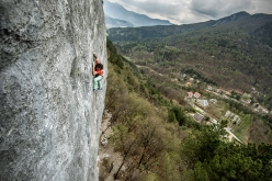 Peter Moser making the first ascent of the climb 'Progetto Bassi' at Celva (TN)