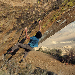 Paul Robinson sticking the crux of Lucid Dreaming V16/Fb8C+, Buttermilks, Bishop, California, USA.