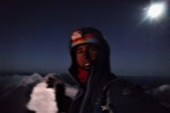 Tomas Franchini on the summit of Mount Edgar (6618m), China, after having made the first ascent of The Moon's Power up the virgin West Face