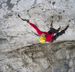 Angelika Rainer dealing with French Connection D15- at the crag Tomorrow's World in the Dolomites