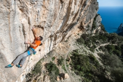 Luca Passini climbing at Cengia Giradili, the panoramic crag at the foot of famous Punta Giradili close to Baunei in Sardinia