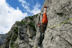 Francesco Salvaterra making the first ascent of La sirenetta, Croz del Rifugio, Val d'Amola, Presanella.