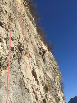Climbing at the sports crag Bordano in Friuli, Italy