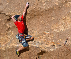 Chris Linder making the second ascent of The Dunce Cap 5.13a at Joshua Tree, USA.