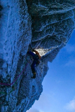 Darkness falls as Guy Robertson makes the first ascent of Lost Arrow Winter Variation at Bidean nam Bian, Glen Coe, Scotland with Greg Boswell. 'Tech 10 moves at the end of a monster day by torch light is not an easy task!'