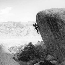 Fabian Buhl grabbing the second ascent of Old Greg, the highball boulder problem freed by Ethan Pringle at Bishop, USA