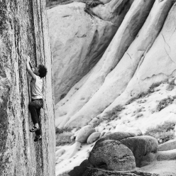 Fabian Buhl edging his way up Too big to flail, the highball at Bishop, USA first ascended by Alex Honnold