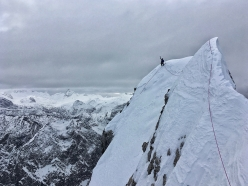 Luka Lindič on the exposed summit of 4th Child (Jungfrau) during the Watzmann Family traverse with Ines Papert