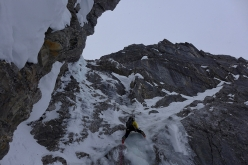 Ines Papert climbing steep water ice at the start of the East Face of Watzmann Mittelspitze during the winter traverse of the Watzmann Family with Luka Lindić