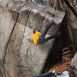 Giuliano Cameroni making the first ascent of the 8B boulder problem Great escape at Cresciano in Switzerland, December 2017