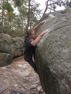 Thomas Comin climbing Karma, the legendary boulder problem at Fontainebleau