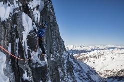 David Lama climbing mixed terrain on Sagzahn - Verschneidung up Sagwand, Valsertal, Austria