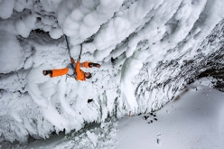 Dani Arnold climbing Power Shrimps at Helmcken Falls, Canada. The first 45 m pitch overhangs almost 30 m