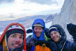 Aguja Val Biois, Patagonia: unfortunately not on the summit, but still super happy. Felix Getzlaff, Lutz Zybell and Tom Ehrig (from left to right) with the flag of our local climbing club back home in Germany at the ridge on top of pitch 12. Our highpoint, where our route joins the normal route to the summit, Filo Sur, and where we started rappelling down this.