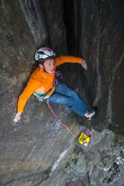 Caroline Ciavaldini inching her way up the glass-like corner of The Quarryman above Llanberis, North Wales in April 2016.
