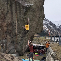 Giuliano Cameroni climbing the 8B highball boulder problem Deal With the Devil at Göschenen in Switzerland
