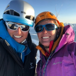 Brette Harrington and Rose Pearson on the summit of Mount Blane, Canada after having made the first ascent of Life Compass