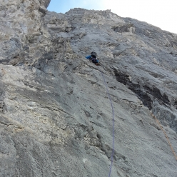 Brette Harrington climbing rocky terrain during the first ascent of Life Compass, Mount Blane, Canada, with Rose Pearson