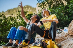 Chris Sharma and Alexander Megos studying the moves of Perfecto Mundo 9b+ at Margalef in Spain