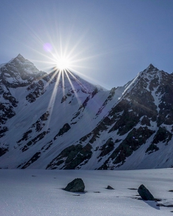 Sunrise directly above Lupghar Sar, the 7181 m peak in the Karakorum, in Pakistan climbed solo by Hansjörg Auer