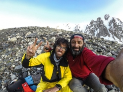 Hansjörg Auerand his cook celebrating after having made the solo first ascent of the West Face of Lupghar Sar West, Karakorum, Pakistan