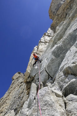 Michael Rinn leading one of the 6a+ pitches on the granite section of the pillar on Perfect Storm, Pointe Louis Amédée, Mont Blanc