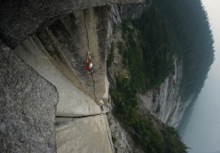 Brette Harrington, belayed by Caro North, making the first ascent of Crouching Tiger, Chinese Puzzle Wall, Canada