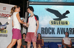 Ruth Oberrauch, Marketing Manager Italy Salewa, handing over the Salewa Rock Award to Adam Ondra