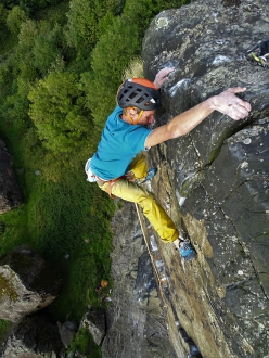 Gérome Pouvreau on the final moves of Rhapsody at Dumbarton Rock in Scotland. Freed by Dave MacLeod in 2006, even today this fine testpiece is recognised as one of the hardest trad climbs in the world
