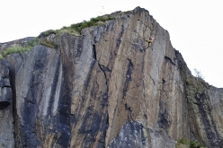 Florence Pinet climbing Requiem at Dumbarton Rock in Scotland. Freed by Dave Cuthbertson in 1983, at the time it was considered the hardest trad climb in the world.