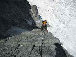 Max Lucco climbing the Cassin Route on the Walker Spur