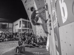 Adam Ondra demonstrating the Speed discipline, watched by Stefano Ghisolfi at the Arco Champions Challenge