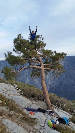 Connor Herson celebrating on the top of El Capitan after his free ascent of The Nose