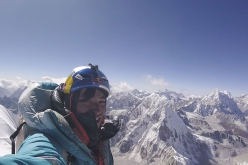 David Lama takes a photo of himself on the summit of Lunag Ri (6907m) in Himalaya on 25/10/2018