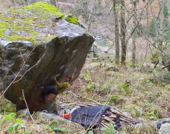 Lorenzo Puri making the first ascent of L'avenir nous reserve big bamboo, the first 8B boulder problemi in Valle di Daone