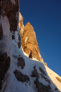 CRAM Cima Brenta: Matteo Faletti setting off after the bivy as dawn breaks on pitch 8.