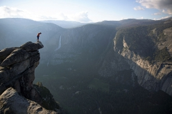Alex Honnold standing high above Yosemite Valley, USA where on 3 June 2017 he carried out the monumental free solo of Freerider up El Capitan